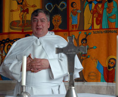 Father John Wisdom in the school chapel