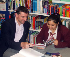 Pupil with a mentor from Manchester University in the school library